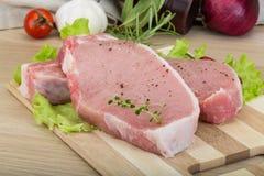 Bistecca grezza del porco Fotografia Stock