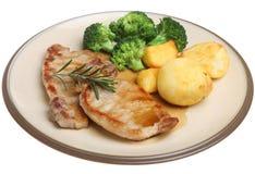 Bistecche della carne della lonza di maiale con le verdure immagini stock libere da diritti