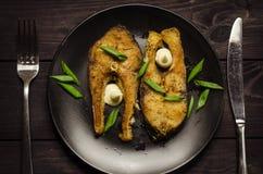 Bistecche di pesci fritte Immagine Stock
