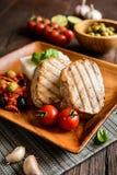 Bistecche di tonno arrostite con riso e salsa al pomodoro Immagine Stock