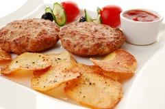 Bistecche fritte con i chip Fotografie Stock