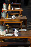 Bistro. Row of wooden tables at a sidewalk cafe stock images
