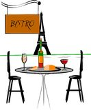 Bistro. Cafe in European city with tower in background Royalty Free Stock Images