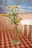 Bistro flowers on table Royalty Free Stock Images