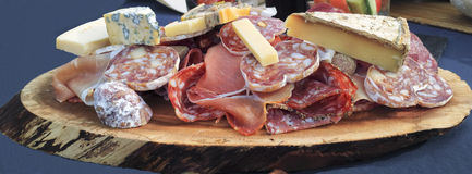 Bistro gourmet food of blue cheese, sausages, meats, pate Stock Images