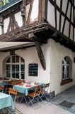 Bistro by a half-timbered house Stock Photo