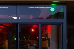 Bistro and pub neon lights. At evening in city mall of south germany metropole stock photography