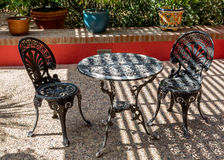 Bistro set with chairs and table. Stock Photo