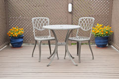 Bistro Table and Chairs on the Deck Royalty Free Stock Image
