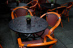 Bistro tables and chairs. Al fresco bistro tables and chairs in the rain Royalty Free Stock Photos