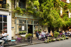 Bistrot au Vieux Paris in France. Paris, France, June 04, 2017 : Famous style of life in Paris, France with bistrrots and people on terraces. Here, this is `The Stock Photos