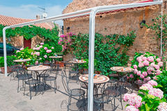 Bistrot. External bistrot surrounded by flowers Stock Image