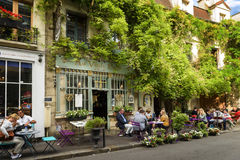 Bistrot the old Paris in France. Paris, France, June 04, 2017 : Famous style of life in Paris, France with bistrrots and people on terraces. Here, this is `The Royalty Free Stock Image
