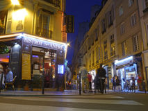 A Bistrot in Paris - A typical Parisian restaurant at night. A long exposure of a beautiful Parisian restaurant close to the Quartier Latin district of the city Stock Photos