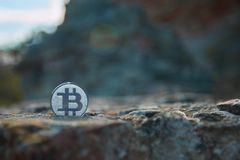 Bit Coin on stone royalty free stock photos