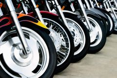Bit del motociclo: Rotelle Immagini Stock