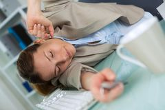 Bit nap in office. A bit of nap in the office royalty free stock images
