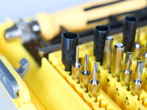 Bit set. A collection of small bits and screwdriver close up Royalty Free Stock Photography