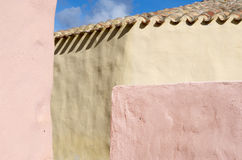 A bit of sky. A bit of blu sky over the roof of this house with pastel walls Stock Photo