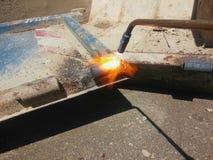 Bitande flamma för metall Fotografering för Bildbyråer