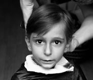 Bitande hår Arkivbild
