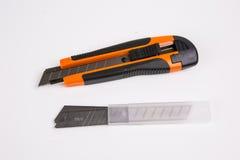 Bitande kniv för kontor royaltyfri foto