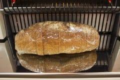 bitande maskin för bröd Arkivfoto