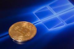 Bitcoin和窗口背景 库存图片