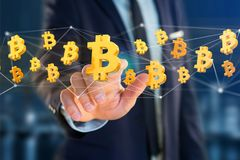 Bitcoin在网络连接附近的标志飞行- 3d回报 库存照片