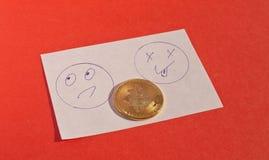 Bitcoin που τοποθετείται στη μέση δύο Smileys Στοκ Εικόνα