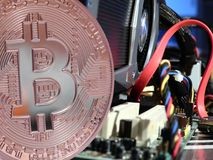 Bitcoin above motherboard royalty free stock image