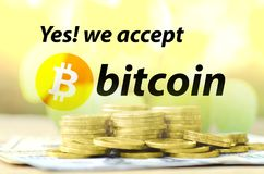 Bitcoin accepted sign with warm light tone and money background. Stock Photo