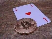 Bitcoin and ace of hearts. Royalty Free Stock Photo