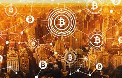 Bitcoin with aerial view of NY skyline Royalty Free Stock Image