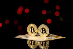 Bitcoin against bokeh background Stock Images