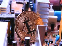 Bitcoin with electronic parts Stock Photo