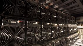 Bitcoin ASIC miners in warehouse. ASIC mining equipment on stand racks for mining cryptocurrency in steel container
