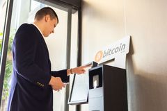 Bitcoin atm and businessman royalty free stock photo