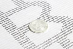 Bitcoin on the background of binary code. Silver bitcoin on the background of binary code royalty free stock images