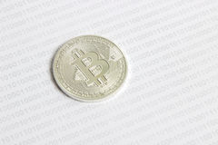 Bitcoin on the background of binary code. Silver bitcoin on the background of binary code stock photos