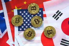 Bitcoin on the Background of Countries Flags stock photography