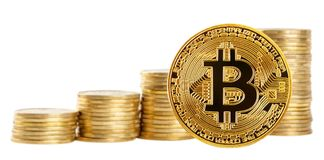 Bitcoin on background of increasing stacks. Of coins isolated on white background. The concept of development and growth of new virtual currency Stock Photos