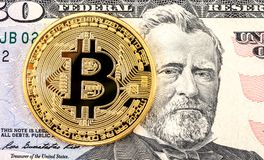 Bitcoin on the banknote of 50 american dollar. Business concept of worldwide cryptocurrency royalty free stock images