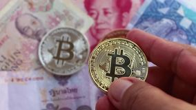 Bitcoin and banknote of Asia groups, such as Thailand, china, Vietnam, and Malaysia. Virtual money concept. stock video