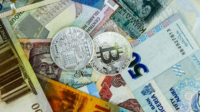 Bitcoin on banknote collage background. Electronic money exchange concept stock images