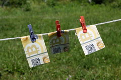 Bitcoin banknotes with clothespins Stock Photography