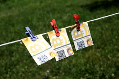 Bitcoin banknotes with clothespins Stock Photo
