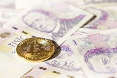 Bitcoin on banknotes of czech crowns. Symbolic coins of bitcoin on banknotes of czech crowns Stock Photography
