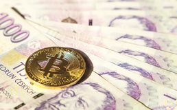 Bitcoin on banknotes of czech crowns. Symbolic coins of bitcoin on banknotes of czech crowns Stock Photos