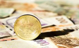 Bitcoin on banknotes of czech crowns. Symbolic coins of bitcoin on banknotes of czech crowns Stock Image
